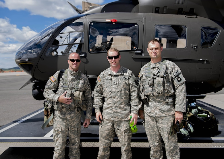 (from left to right) Chief Warrant Officer 3 Chris Haeder, Lakota pilot, Sgt. Darrell Russell, crew chief, and Chief Warrant Officer 2 Chris Mason, Lakota pilot of C Company, 1st Battalion, 112th Airborne Regiment, stand outside their helicopter June 14, 2017, at Fairchild Air Force Base, Washington. The National Guard 112th Airborne Regiment are a tenant unit at Fairchild.