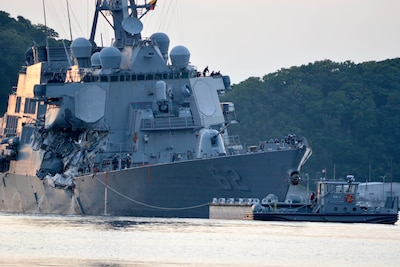 The Arleigh Burke-class guided-missile destroyer USS Fitzgerald returns to Fleet Activities Yokosuka following a collision with a merchant vessel while operating southwest of Yokosuka, Japan. Navy photo by Petty Officer 1st Class Peter Burghart