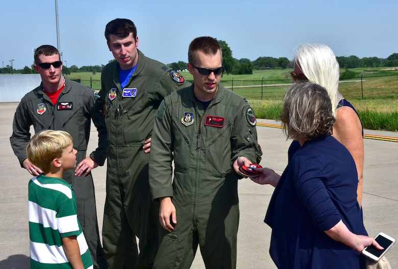 Capt. Christopher Shelly, 76th Fighter Squadron pilot, gives Lynn Evans, John Dean Armstrong's niece, replica patches from the Flying Tigers unit that her uncle was part of, June 17, 2017, at McConnell Air Force Base, Kan. Evans and members of her family laid Armstrong to rest after searching for their missing family member's remains for 13 years. (U.S. Air Force photo/Staff Sgt. Trevor Rhynes)