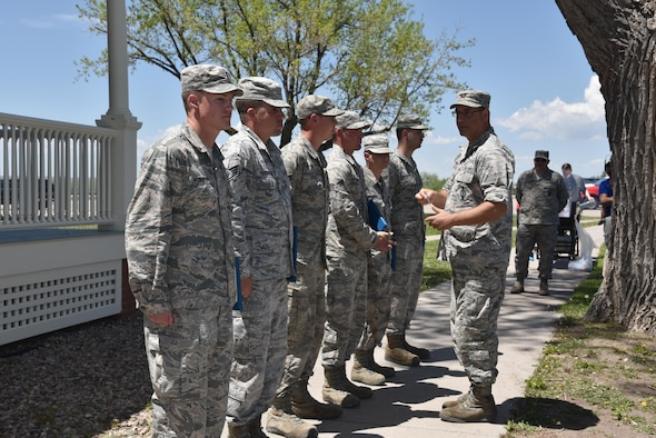 90th Civil Engineer Airmen are awarded the Air Force Achievement medal and receive coins from Col. Stephen Kravitsky, 90th Missile Wing commander for the restoration of the historic Fort D. A. Russell Army post headquarters at F.E. Warren Air Force Base, Wyo., June 8, 2017. The renovation project served a dual purpose by providing a rare training opportunity to prepare civil engineer Airmen for their responsibilities when deployed to foreign countries. Building 210 will act as the MSG headquarters and a receptions hall for Distinguished Visitors. (U.S. Air Force photo by 2nd Lt. Nikita Thorpe)