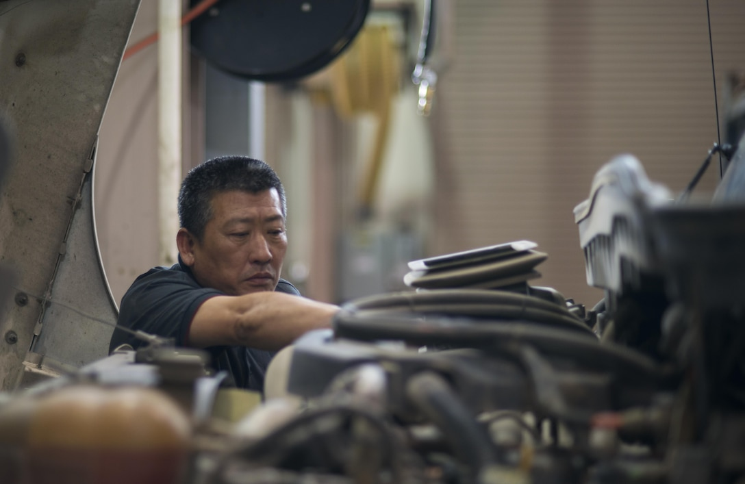 Pak Min-ok, 51st Logistics Readiness Squadron vehicle maintainer, repairs a street sweeper in the Vehicle Maintenance shop at Osan Air Base, Republic of Korea on June 13, 2017. The Vehicle Maintenance unit ensures Team Osan's 1,300 government owned vehicles remain mission capable. (U.S. Air Force photo by Staff Sgt. Alex Fox Echols III)