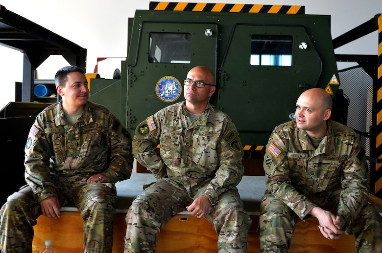 (From left) U.S. Air Force Master Sgts. Jason Barkey, Richard Koch, and Steven Hollatz, all from the 7th Weather Squadron, sit in front of a Humvee egress assistance trainer on Lucius D. Clay Kaserne, Germany, June 14, 2017. The 7th WS conducted Exercise Cadre Focus 17-1, which aims to enhance the ability of its Airmen to cooperate with the U.S. Army in Europe. While administratively part of the Air Force, the squadron provides weather support to the U.S. Army. (U.S. Air Force photo by Airman 1st Class Joshua Magbanua)