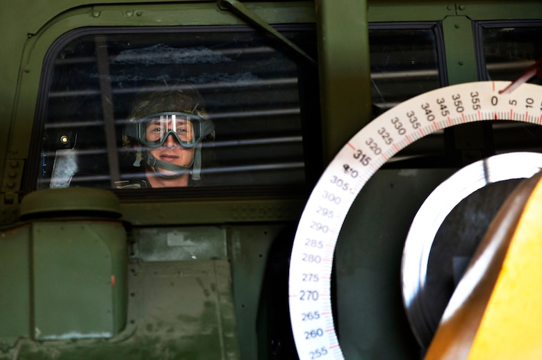 Maj. Richard Büki, a senior meteorologist for the Geoinformation Service of the Hungarian Defense Forces, sits in a Humvee egress assistance trainer on Lucius D. Clay Kaserne, Germany, June 14, 2017. NATO allies from Germany, Poland, and Hungary, participated in the 7th Weather Squadron's Exercise Cadre Focus 17-1. 2017 is the first year Hungarian service members participated in the exercise. (U.S. Air Force photo by Airman 1st Class Joshua Magbanua)