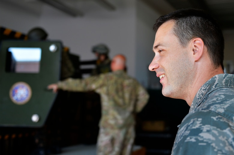 U.S. Air Force Staff Sgt. Dallas Rhodes, 7th Weather Squadron unit deployment manager, watches as troops enter a Humvee egress assistance trainer on Lucius D. Clay Kaserne, Germany, June 14, 2017. The 7th WS conducted Exercise Cadre Focus 17-1, which aims to help its Airmen enhance their ability to integrate with the U.S. Army. German, Polish, and Hungarian service members also participated in the exercise. (U.S. Air Force photo by Airman 1st Class Joshua Magbanua)
