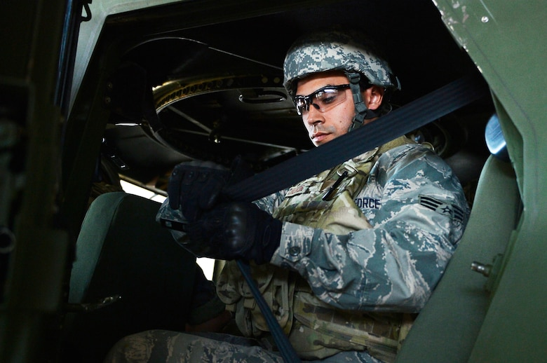 U.S. Air Force Senior Airman Jose Peregrina-Flores, 7th Weather Squadron regional maintenance technician, straps himself to a Humvee egress assistance trainer on Lucius D. Clay Kaserne, Germany, June 14, 2017. The 7th WS conducts HEAT training annually in order to ensure its Airmen are capable of evacuate a rolled-over Humvee. The squadron is responsible for providing weather support to U.S. Army operations in Europe. (U.S. Air Force photo by Airman 1st Class Joshua Magbanua)