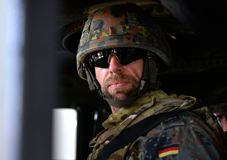 German Air Force Senior Master Sgt. Guido Jantos sits in a Humvee egress assistance trainer on Lucius D. Clay Kaserne, Germany, June 14, 2017. The 7th Weather Squadron invited NATO allies to participate in Exercise Cadre Focus 17-1. The exercise aimed to enhance the ability of 7th WS Airmen to integrate with the U.S. Army. (U.S. Air Force photo by Airman 1st Class Joshua Magbanua)