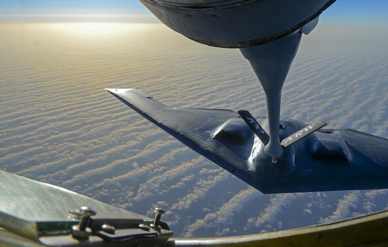 A U.S. Air Force B-2 Spirit from Whiteman Air Force Base, Mo., flies into position to receive fuel from a KC-135 Stratotanker assigned to the 100th Air Refueling Wing, RAF Mildenhall, England, off the coast of Spain, June 13, 2017. The B-2 brings massive firepower to bear, in a short time, anywhere around the globe. The aircraft's capability to penetrate air defenses and threaten effective retaliation provides a strong, effective deterrent and combat force well into the 21st century. (U.S. Air Force photo by Staff Sgt. Micaiah Anthony)