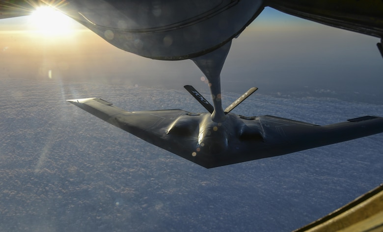A U.S. Air Force B-2 Spirit from Whiteman Air Force Base, Mo., flies away after receiving fuel from a KC-135 Stratotanker assigned to the 100th Air Refueling Wing, RAF Mildenhall, England, off the coast of Spain, June 13, 2017. Two B-2s deployed to the U.K. to participate in theater bomber assurance and deterrence operations. Bomber deployments enhance the readiness and training necessary to respond to any contingency or challenge across the globe. (U.S. Air Force photo by Staff Sgt. Micaiah Anthony)