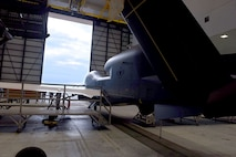 Lt. Gen. Lee Levy II, Air Force Sustainment Center commander, met with  members of Team Robins about work being done on a Global Hawk here during his site visit June 13. This is the first time a Global Hawk has flown into  an Air Force air logistics complex. Warner Robins Air Logistics Complex maintenance professionals are meticulously painting the aircraft to prevent corrosion. Robins Air Force Base is the first installation to have a building-based Launch and Recovery Element, allowing the aircraft to take off and land from this location. While a programmed depot maintenance requirement for Global Hawk has not been established, the Air Force recognizes that having an organic maintenance capability for Global Hawk enhances our ability to manage the fleet and keep this resource flying. (U.S. Air Force photo/TOMMIE HORTON)