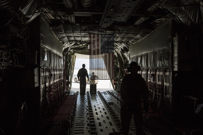 U.S. Marines stand inside a KC-130J, in the Central Command area of operations, June 18, 2017. Commandant of the Marine Corps Gen. Robert B. Neller visited Marines with Special Purpose Marine Air Ground Task Force Central Command engaged in Operation Inherent Resolve aimed at destroying ISIS.