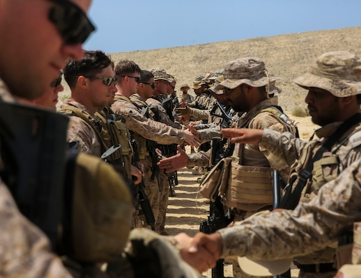 U.S. Marines with Charlie Company, 1st Battalion, 7th Marine Regiment, Special Purpose Marine Air-Ground Task Force-Crisis Response-Central Command, exchange gifts with Saudi Arabian Naval Special Forces at the end of a subject matter expert exchange while forward deployed in the Middle East, May 18, 2017. The exchange proved to be an enhancing opportunity for both the U.S. and Saudi forces. Deploying U.S. Marines into the U.S. Central Command area of responsibility to conduct combined military training with our partner nations' security forces strengthens our vital relationships with partners in this important region.