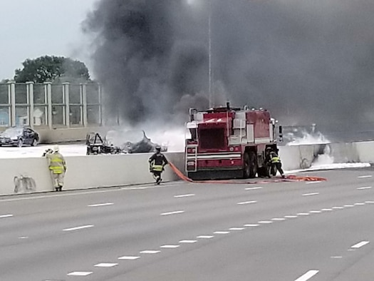 Wright-Patterson fire fighters assist Dayton first responders as they battle a major fuel fire on I-75 April 30, 2017 in Dayton, Ohio. After using foam to combat the fire from the ARFF crash vehicle, Wright-Patterson fire fighters passed hoses to Dayton fire fighters to extinguish the remaining fire. (U.S. Air Force photo/Keith Hawkins)