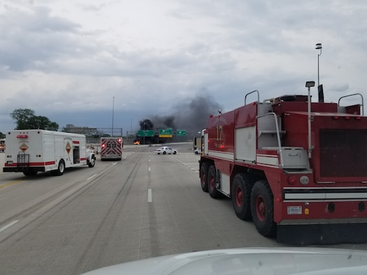 """Crash 17,"" one of Wright-Patterson's Aircraft Rescue and Fire Fighting trucks, arrives on site to assist Dayton first responders as they battle a major fuel fire on I-75 April 30, 2017 in Dayton, Ohio. The ARFF, specifically designed to combat aircraft fires, was called in to help due its unique capabilities in fighting fires of this type. (U.S. Air Force photo/Keith Hawkins)"