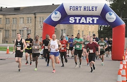 Fort Riley Soldiers begin running 10 miles to compete for a spot on the Ten-Miler team June 3 at King Field House. Staff of the Directorate of Family and Morale, Welfare and Recreation hosted the qualifying run as a separate event this year because the usual event is scheduled during Victory Week.