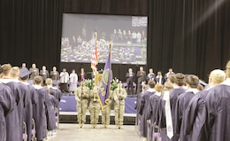 A Color Guard from the 1st Infantry Division Sustainment Brigade participated in the Manhattan High School 2017 graduation ceremony May 21 at Kansas State University's Fred Bramlage Coliseum in Manhattan, Kansas.
