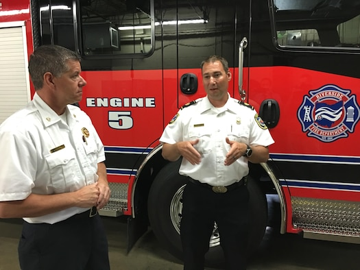 Fire Chief Jacob King, Wright-Patterson Air Force Base Fire Emergency Services (right) discusses mutual aid operations with Fire Chief Daniel Stitzel, city of Riverside Fire Department, in front of Riverside's newest fire engine June 9, 2017 in Riverside, Ohio. Both departments routinely provide mutual aid to one another in the form of firefighting, medical, diving and other emergency response services. (U.S. Air Force photo/John Harrington)