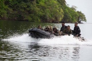 Members of 1st and 2nd Infantry Battalion, Trinindad and Tabago Infantry Regiment, Trinidad and Tobago Defence Force, and soldiers from the Belize Defense Force simulate a beach raid during Phase II of Exercise Tradewinds 2017 in Port of Spain, Trinidad and Tobago, June 13, 2017. Tradewinds, an annual U.S. Southern Command-sponsored exercise, brings together 20 partner nations to increase Caribbean security and the combined ability to counter transnational terrorism and organize crime, and enhance humanitarian and disaster relief capabilities.  (U.S. Marine Corps photo by Sgt. Clemente C. Garcia)