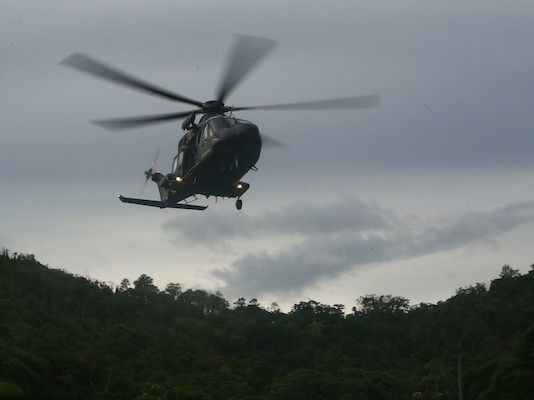 A Trinidad and Tobago Defense Force helicopter approaches its landing zone for insert as part of a simulated aerial and maritime raid during Exercise Tradewinds 2017 Phase II in Chaguaramas, Trinidad and Tobago, June 13, 2017. Tradewinds, an annual U.S. Southern Command-sponsored exercise, brings together 20 partner nations to increase Caribbean security and the combined ability to counter transnational terrorism and organize crime, and enhance humanitarian and disaster relief capabilities. (U.S. Marine Corps photo by Sgt. Olivia McDonald)