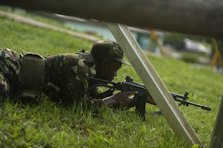 A soldier with Trinidad and Tobago Infantry Regiment, Trinidad and Tobago Defence Force, takes cover before raiding his objective during Exercise Tradewinds 2017 Phase II in Chaguaramas, Trinidad and Tobago, June 13. Tradewinds, an annual U.S. Southern Command-sponsored exercise, brings together 20 partner nations to increase Caribbean security and the combined ability to counter transnational terrorism and organize crime, and enhance humanitarian and disaster relief capabilities. (U.S. Marine Corps photo by Sgt. Olivia McDonald)