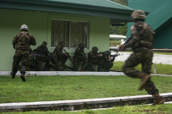 Belize Defence Force soldiers take cover while conducting a simulated aerial and maritime raid during Exercise Tradewinds 2017 Phase II in Chaguaramas, Trinidad and Tobago, June 13, 2017. Tradewinds, an annual U.S. Southern Command-sponsored exercise, brings together 20 partner nations to increase Caribbean security and the combined ability to counter transnational terrorism and organize crime, and enhance humanitarian and disaster relief capabilities. (U.S. Marine Corps photo by Sgt. Olivia McDonald)