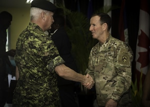 PORT OF SPAIN, Trinidad - Lieutenant-Colonel John Woodgate, Commanding Officer of 1st Field Artillery Regiment, greets Lieutenant-General Joseph DiSalvo from the United States Army during Exercise TRADEWINDS 17 closing ceremony in Chaguaramas, Trinidad and Tobago on June 17, 2017.