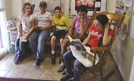 Children and pre-teens read together during the Summer Reading Program start party June 3 at the Fort Riley Post Library. The program, which runs from Memorial Day to the first week of August, keeps kids reading during their summer vacation so they can continue to improve their skills in a fun, social manner, said Terri Seaman, contract manager for the Fort Riley Post Library.