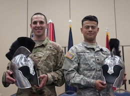 U.S. Army Reserve Non-Commissioned Officer of the Year winner, Cpl. Carlo Deldonno (left) representing the 3rd Medical Command (Deployment Support), and U.S. Army Reserve Soldier of the Year, Spc. Kenny Ochoa (right) representing the 79th Sustainment Support Command, pose together holding their Best Warrior trophy helmets during 2017 U.S. Army Reserve Best Warrior Competition awards ceremony held at the Iron Mike Conference Center, Ft. Bragg, N.C. June 16. This year's Best Warrior Competition determined the top noncommissioned officer and junior enlisted Soldier who will represent the U.S. Army Reserve in the Department of the Army Best Warrior Competition later this year at Fort A.P. Hill, Va. (U.S. Army Reserve photo by Sgt. William A. Parsons) (Released)