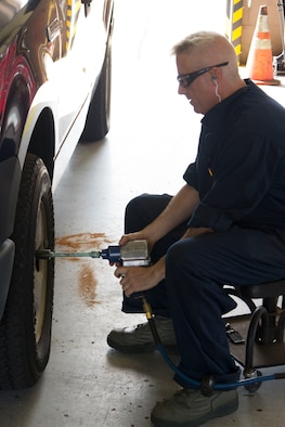 Tech. Sgt. Aaron Kincheloe, 442nd Logistics Readiness Squadron vehicle maintenance, uses a pneumatic impact wrench to attach a wheel to a fleet vehicle at Eglin Air Force Base, Fla., during the squadron's deployment for training May 6-20.  Sixty-eight Citizen Airmen from the 442 LRS and 442nd Force Support squadron completed a two-week training tour at Eglin and Duke Field, Fla., to hone home station and mission-readiness skills.