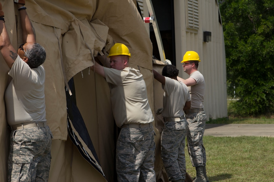 Master Sgt. Sonija Nelson, Tech. Sgt. Jason Billingsley and Tech. Sgt. Aaron Hooper, from the 442nd Force Support Squadron's Services Flight, construct a tent with a member of the 919th Force Support Squadron, which is part of a single pallet expeditionary kitchen used for preparing food in deployed locations.  The 919 FSS hosted the 442 FSS members during a two-week deployment for training to Duke Field, Fla., May 6-20.