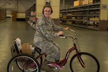 PR Hannah Campbell (TMO) -- Senior Amn. Hannah Campbell, 442nd Logistics Readiness Squadron Traffic Management Office, retrieves shipments of supplies via three-wheeled bike inside a warehouse at Eglin Air Force Base, Fla.   Sixty-eight Citizen Airmen from the 442 LRS and 442nd Force Support squadron completed a two-week training tour at Eglin and Duke Field, Fla., to hone home-station and mission-readiness skills.