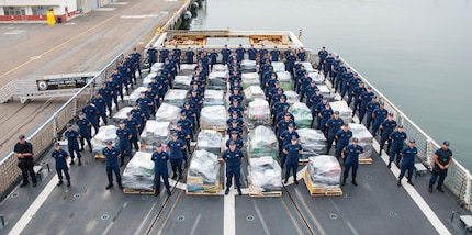 U.S. Coast Guardsmen aboard the USCGC Waesche (WMSL 751), homported in Alameda, California, stand alongside approximately 18 tons of cocaine in San Diego on June 15, 2017. The narcotics were seized during 18 separate interdictions in the Eastern Pacific Ocean from March through June 2017. (U.S. Coast Guard photo by Petty Officer 3rd Class Davonte Marrow)