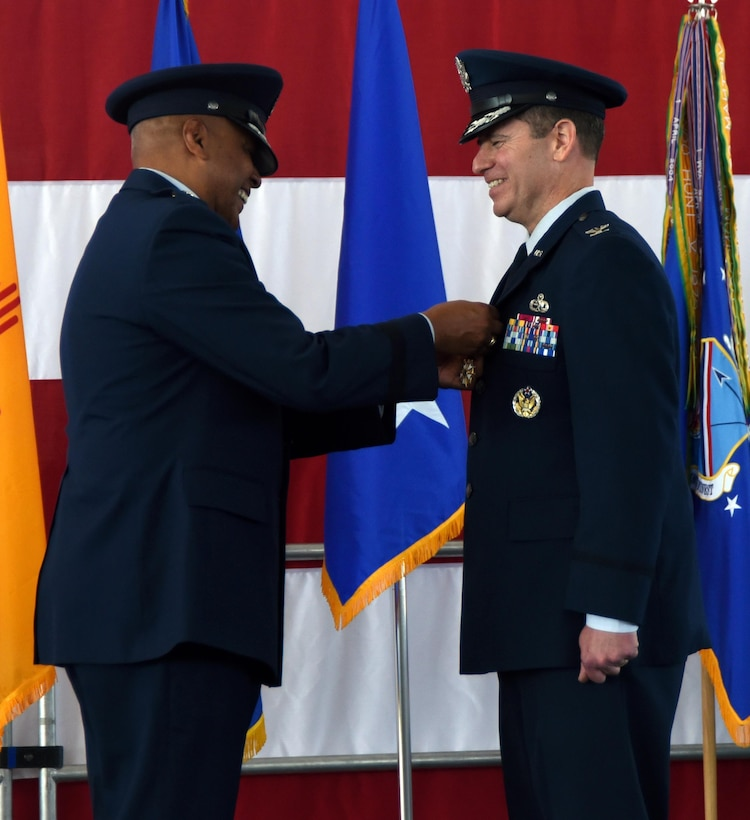 Maj. Gen. Anthony Cotton, 20th Air Force commander, pins the Legion of Merit on Col Eric H. Froehlich during a change of command ceremony at Kirtland Air Force Base, New Mexico, June 16. Froehlich commanded the wing during its first unit effectiveness inspection, where the wing was rated excellent. (U.S. Air Force photo by Senior Airman Chandler Baker)