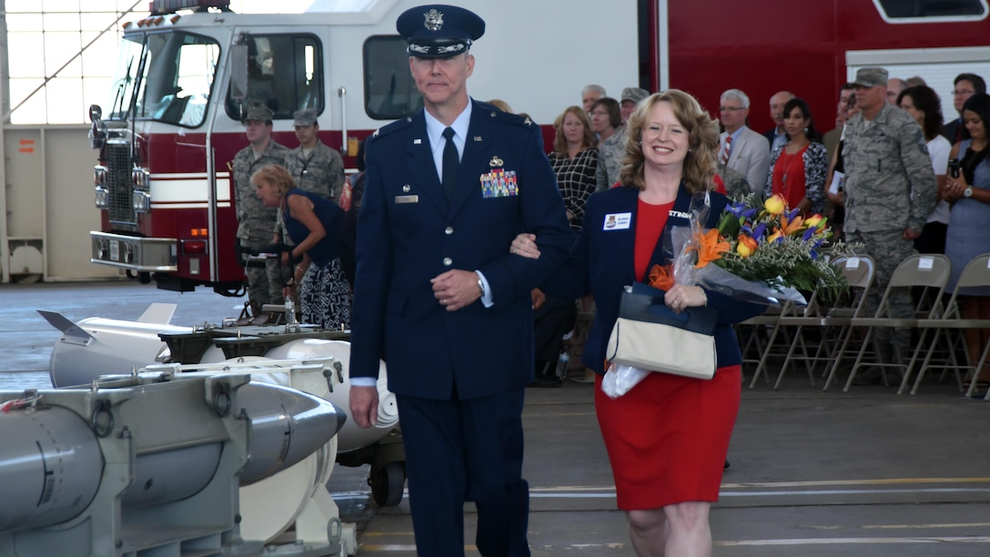 Col Richard W. Gibbs, 377th Air Base Wing commander, escorts his wife, Robin, following a change of command ceremony at Kirtland Air Force Base, New Mexico, June 16. Gibbs takes command of the host unit at Kirtland, which supports over 100 mission partners. (U.S. Air Force photo by Senior Airman Chandler Baker)