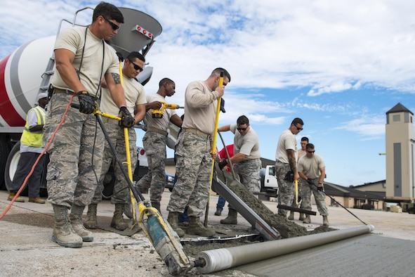 Students use various concrete leveling tools to finish a new patch of cement during a Pavements Maintenance, Inspection and Repair course, June 15, 2017, at Moody Air Force Base, Ga. Every year, training managers at the major command level across the Air Force pick multiple bases across the Air Force to host the course, and this year Moody hosted one from June 5-16. (U.S. Air Force photo by Senior Airman Janiqua P. Robinson)