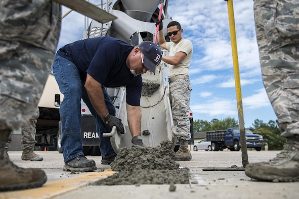 Students watch as an instructor adds cement mix to a hole before finishing a new patch of cement during a Pavements Maintenance, Inspection and Repair course, June 15, 2017, at Moody Air Force Base, Ga. Every year, training managers at the major command level across the Air Force pick multiple bases across the Air Force to host the course, and this year Moody hosted one from June 5-16. (U.S. Air Force photo by Senior Airman Janiqua P. Robinson)