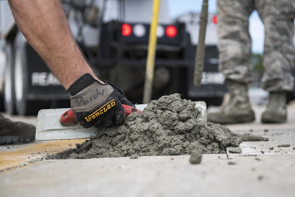 A student uses a leveling tool to finish a new patch of cement during a Pavements Maintenance, Inspection and Repair course, June 15, 2017, at Moody Air Force Base, Ga. Every year, training managers at the major command level across the Air Force pick multiple bases across the Air Force to host the course, and this year Moody hosted one from June 5-16. (U.S. Air Force photo by Senior Airman Janiqua P. Robinson)
