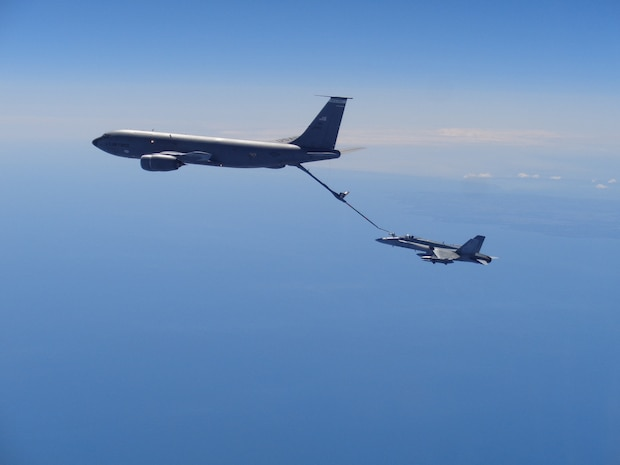 A Canadian NORAD Region (CANR) CF-18 Hornet refuels from a United States Air