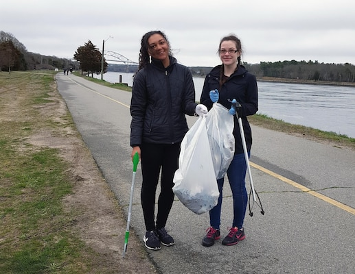 Volunteers from AmeriCorps, Cape Cod pick up trash along the banks of the Cape Cod Canal during the Cape Cod Canal Clean up event, April 22, 2017.