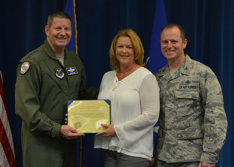 Gen. Robin Rand, Air Force Global Strike Command commander, presents the Air Force 2017 General and Mrs. Jerome O'Malley Award to Col. Eric H. Froehlich and his wife Stephanie during a ceremony at Kirtland Air Force Base, N.M. June 15. The Forehlichs will be invited to Washington D.C. later this year to officially accept the award. (U.S. Air Force Photo by Senior Airman Bethany La Ville)