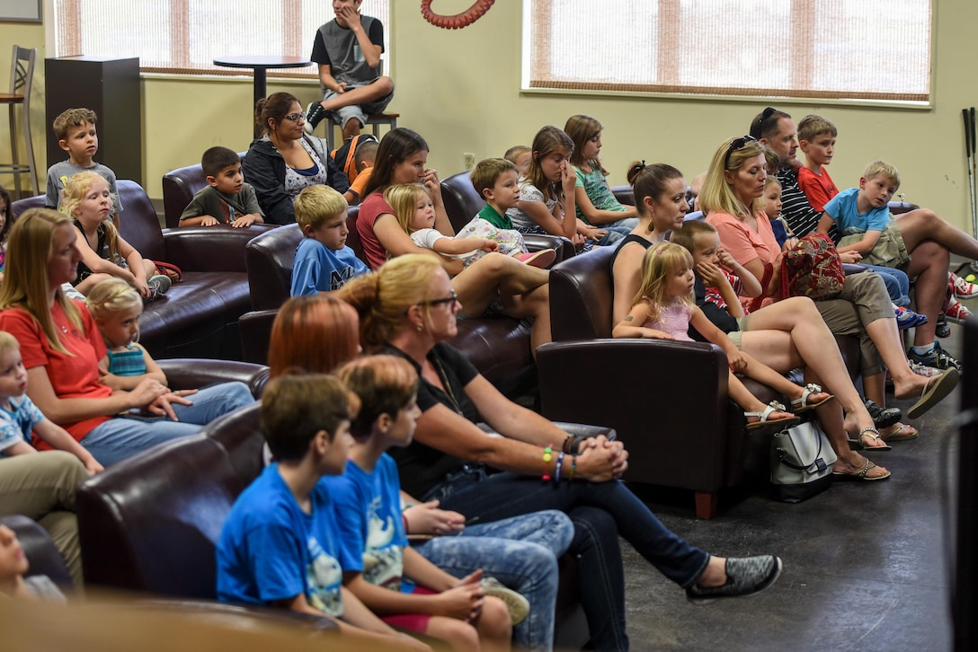 Children and their parents listen to a story during a Summer Reading Program event at Hurlburt Field, Fla., June 15, 2017. The program is hosted by the Hurlburt Field Library during the summer months to keep Air Commandos engaged in reading throughout summer vacation. (U.S. Air Force photo by Staff Sgt. Jeff Parkinson)