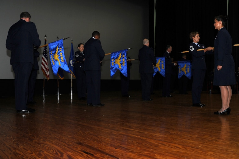 Senior group and squadron leaders unfurl guidons of the new 11th Medical Group during an activation ceremony June 16, 2017 at Joint Base Andrews, Md. The ceremony marks the transition of hundreds of the Capital Medics from the 779th MDG to the 11th MDG. (Photo by Staff Sgt. Joe Yanik)