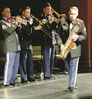 "Members of the ""Big Red One"" Brass Band play ""Killing Me Softly"" as arranged by the Youngblood Brass Band during their Spring Concert Series ""The History of the Division"" at the C.L. Hoover Opera House May 25 in Junction City, Kansas."