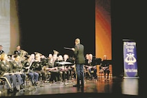 "The 1st Infantry Division Band plays alongside members of the Junction City Community Band during their Spring Concert Series ""The History of the Division"" at the C.L. Hoover Opera House May 25 in Junction City, Kansas. The concert showcased the history of the division over the last 100 years."