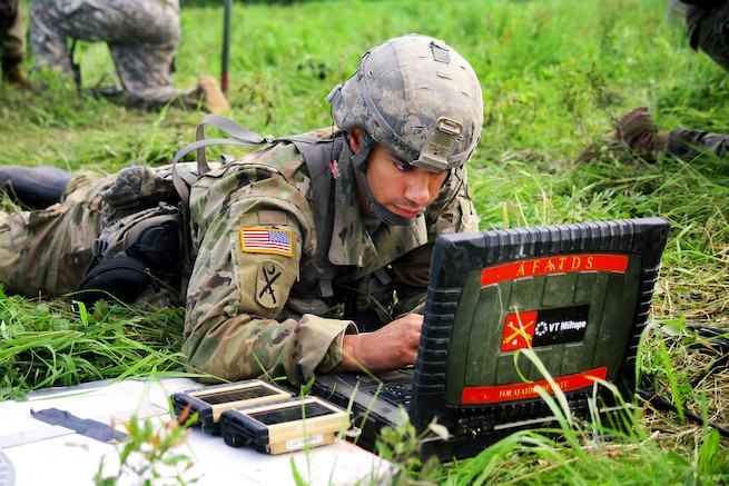 Army Sgt. Victor Sanchez operates an advanced field artillery tactical data system to calculate aiming data for an M119A2 105mm howitzer during an air assault artillery raid at Fort Drum, N.Y., June 9, 2017. Sanchez is a fire direction coordinator assigned to Alpha Battery, 1st Battalion, 258th Artillery Regiment, 27th Infantry Brigade Combat Team of the New York Army National Guard. Army photo by Sgt. Alexander Rector
