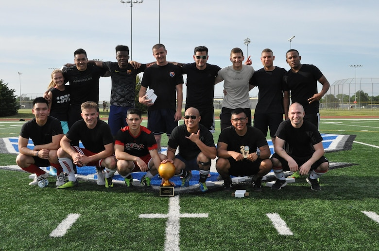 The MOF Hooligans gather around the spring 2017 intramural soccer championship trophy May 31 after defeating Security Forces 3-0. The team also won last season's tournament in fall 2016. Names have been withheld in accordance with an Air Combat Command directive for the personal safety of its Airmen. (Air Force photo by John Parker)