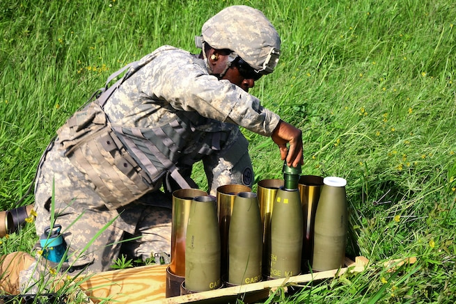 Army Spc. Matthews Ocansey prepares rounds to be fired from an M119A2 105mm howitzer during an air assault artillery raid at Fort Drum, N.Y., June 9, 2017. Natole is a cannon crewmember assigned to Alpha Battery, 1st Battalion, 258th Artillery Regiment, 27th Infantry Brigade Combat Team of the New York Army National Guard. Army  photo by Sgt. Alexander Rector