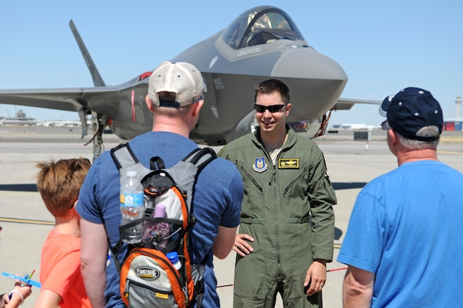 Lt. Col. David DeAngelis, a Reserve F-35 pilot from the 419th Fighter Wing at Hill Air Force Base, talks with Utah Air National Guard Airmen and their family members during Wingman Day on June 10, 2017 at Roland R. Wright Air National Guard Base. Hill AFB provided an F-35 Lightning II aircraft and an F-16 Fighting Falcon as static displays for the event, which drew more than 1,000 guests to the Guard base in Salt Lake City. (U.S. Air National Guard photo by Tech. Sgt. Amber Monio)