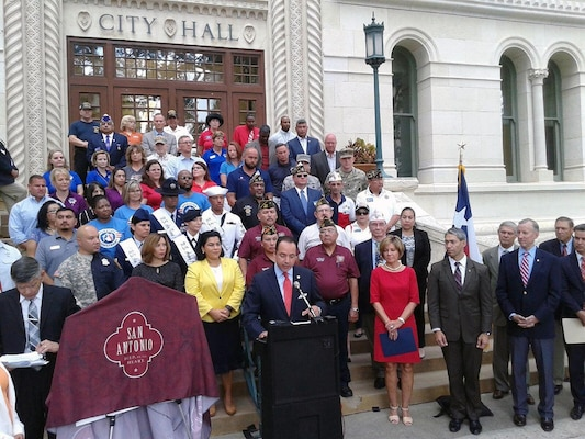 Texas State Senator Jose Menendez (District 26) speaks to those gathered at the unveiling ceremony for the newly trademarked Military City USA logo at City Hall June 19.