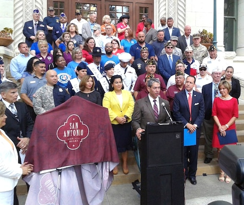City of San Antonio Mayor-Elect Ron Nirenberg speaks to those gathered at the unveiling ceremony for the newly trademarked Military City USA logo June 19 at City Hall.