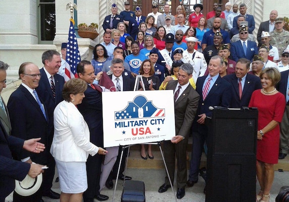 "City of San Antonio Mayor-Elect Ron Nirenberg and others pose with the newly revealed official logo for ""Military City USA"" during a ceremony at City Hall June 19. ""For years many have referred to San Antonio as Military City, USA and now we are officially a registered trademark, a name that no other city can claim.  Our relationship with the military is one of the many reasons our city continues to prosper and we are proud to celebrate this historic announcement,"" Nirenberg said. ""Thank you to the entire military community, their families, and the service men and women who call San Antonio home."""